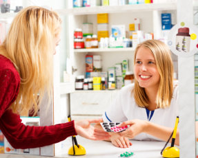 pharmacist holding medicine syrup