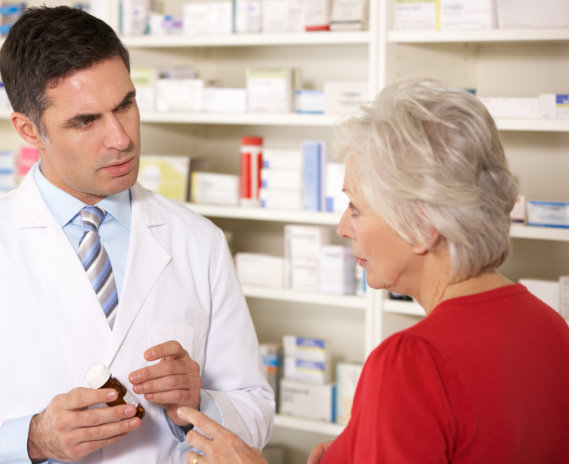 pharmacist talking to an elderly woman