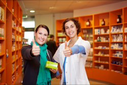 customer and pharmacist smiling