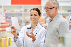 pharmacist talking to an elderly man